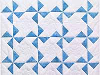 Sterling Blue and Cream Pinwheel Crib Quilt