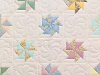 Pastel  Pinwheels Crib Quilt