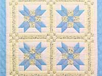 Pastel Blue and Yellow Nine Patch Star Crib Quilt