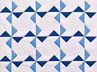 Navy Blue and Cream Pinwheels Crib Quilt
