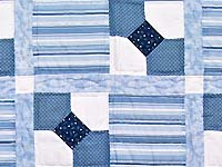 Blue and Cream Bow Tie Crib Quilt