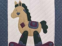 Blue and Purple Rocking Horse Crib Quilt