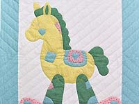 Pastel Aqua Blue and Pink Rocking Horse Crib Quilt