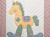 Rosy Pink and Blue Rocking Horse Crib Quilt