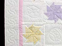 Pastel Pink and Multicolor Pinwheels Crib Quilt
