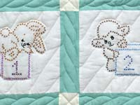 Green and Cream Cross Stitch Animals Crib Quilt