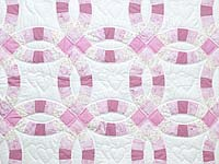 Pink and Cream Double Wedding Ring Crib Quilt