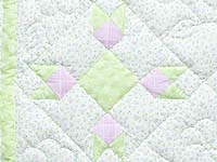 Pastel Green Pink and Cream Rabbits Paw Crib Quilt