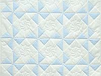 Pastel Blue and Cream Pinwheel Crib Quilt