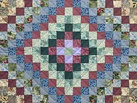 Blue and Multicolor Hit or Miss Crib Quilt