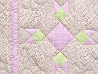 Pastel Green and Pink Rabbits Paw Crib Quilt