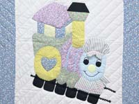 Pastel Blue and Pink Thomas Train Crib Quilt