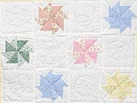 Pastel Yellow and Multicolor Pinwheels Crib Quilt
