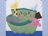 Pastel Blue and Rosy Red Noahs Ark Crib Quilt