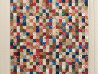 Tan and Multicolor Hit or Miss Crib Quilt