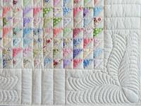 Pastel Triangles Crib Quilt