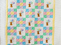 Pastel Nine Patch Party Bears Crib Quilt