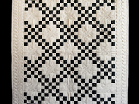 Black and Dark Tan Irish Chain Quilt