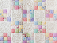 Pastel and White Nine Patch Crib Quilt