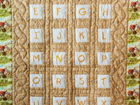 ABC Embroidered Crib Quilt