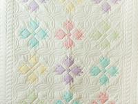 Soft Pastel & White Bear's Paw Crib Quilt