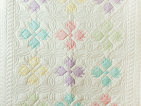 Soft Pastel & White Bear's Paw Crib Quilt