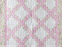 Pink and Cream Dogwood Blossom Irish Chain Quilt