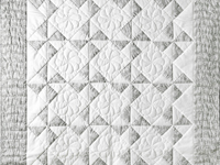 Pristine Gray and White Pinwheel Quilt