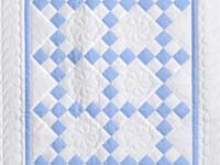 Soft Blue and White Nine Patch Crib Quilt