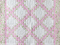 Pink and Cream Dogwood Blossom Irish Chain Quilt
