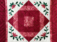 Rich Red Log Cabin and Appliqued Sprigs Wall Hanging