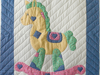 Pastel and White Hand Appliqued Rocking Horse Crib Quilt