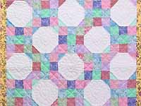 Pink, Pastel and White Nine Patch Variation Crib Quilt