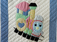 Blue and Pastel Thomas Train Crib Quilt