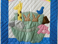 Bright Blue and Pastel Noah's Ark Appliqued Crib Quilt