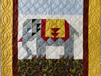 Gray and Gold Delightful Elephant Quilt