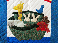 Blue and Multicolor Noah's Ark Crib Quilt