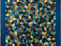 Blue and Brown Tumbling Blocks Quilt