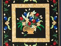 Original C J Horst Design Spring Basket Medley Bright reds/blues/golds on Black