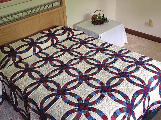 Blue Burgundy and Multicolor Double Wedding Ring Quilt Photo 1