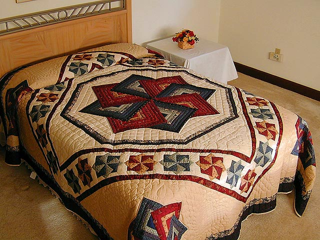 Navy and Burgundy Star Spin Quilt Photo 1