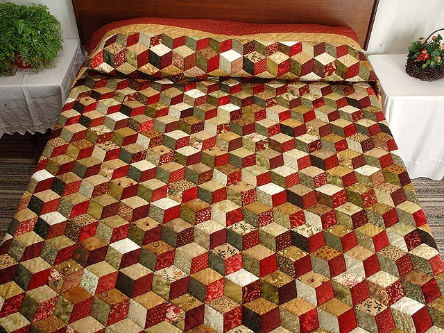 Red Gold and Multicolor Tumbling Blocks Quilt Photo 1