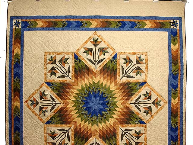 Blue Gold and Green Flowering Star Quilt Photo 2