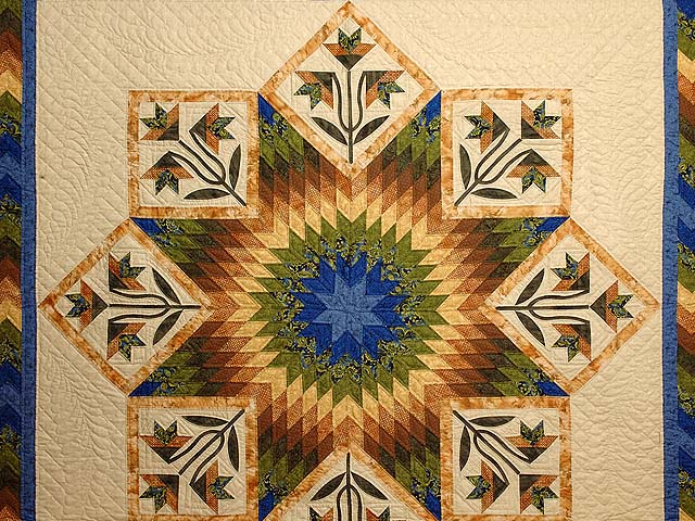 Blue Gold and Green Flowering Star Quilt Photo 3