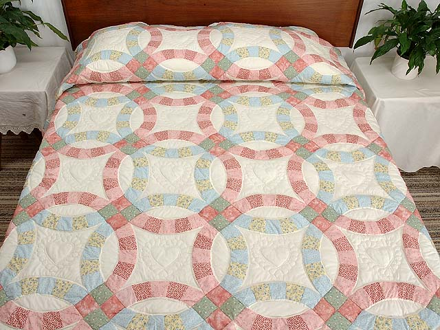 Pastel Pink and Blue Double Wedding Ring Quilt Photo 1