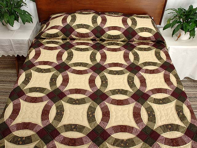 Purple Green and Tan Double Wedding Ring Quilt Photo 1