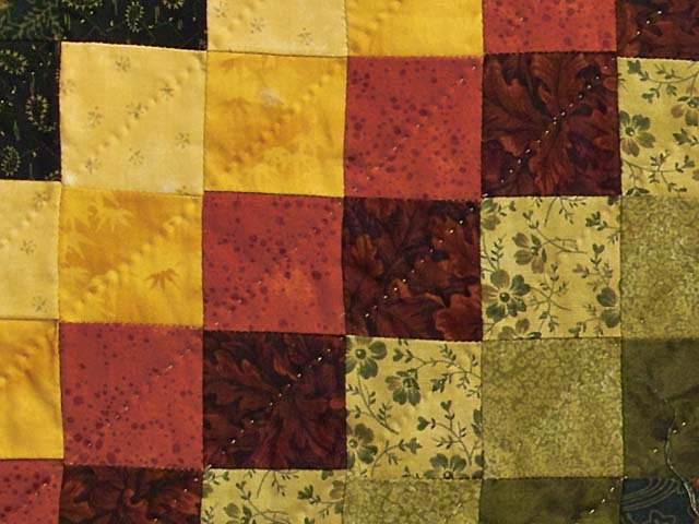 Green Red and Gold Compass Trip Quilt Photo 5
