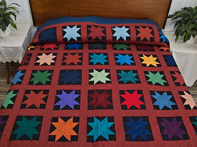 Blue Burgundy and Multi Amish Variable Stars Quilt Photo 1
