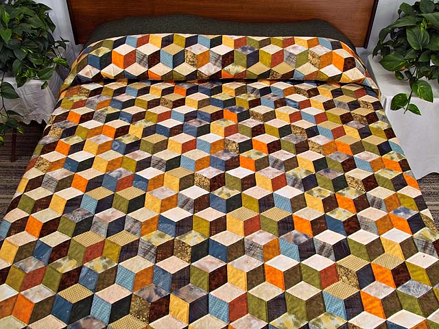 Green and Multicolor Tumbling Blocks Quilt Photo 1