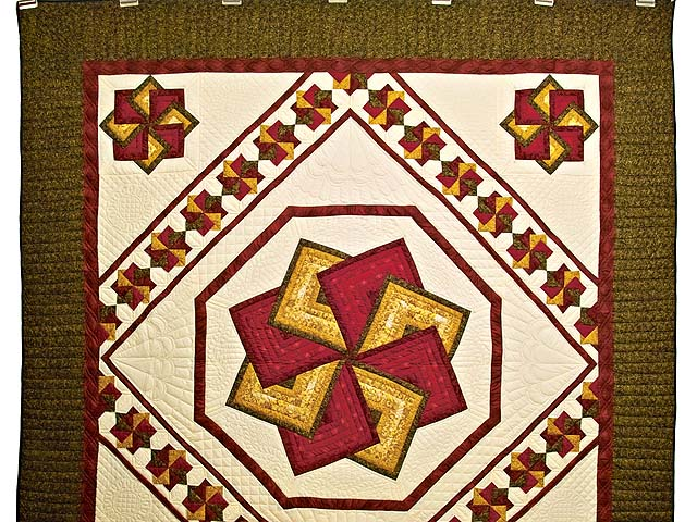 Green Burgundy and Gold Star Spin Quilt Photo 2